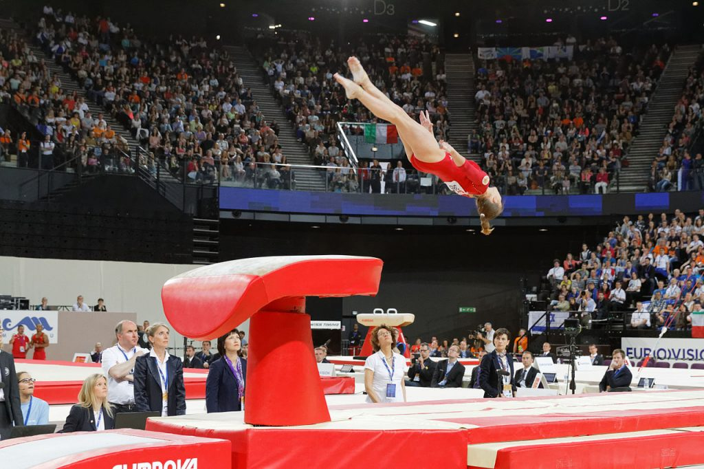 Woman Jumping High for European Artistic Gymnastics Championships